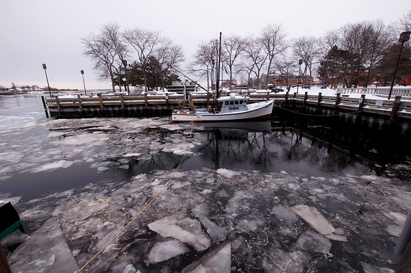 JIM VAIKNORAS/Staff photo The Early Times sits in a ice chocked embayment Newburyport Saturday morning. The artic weather is predicted to last for the next few days, and then return for the weekend.