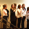 BRYAN EATON/Staff photo. The Amesbury Middle School Melody Club leads the attendees in the National Anthem.