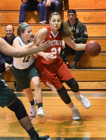 BRYAN EATON/Staff photo. Napolie tries for a layup past Pentucket's Jess Galvin.