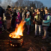 JIM VAIKNORAS/Staff photo People toast marshmallows  at the Old Newbury Christmas tree Bonfire at the Tendercrop Farm fields and Spencer Perce-Little Farm in Newbury Saturday night.