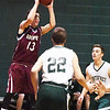 BRYAN EATON/Staff photo. Rockport guard Austin Matus jumps to shoot at Pentucket High School.