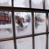 JIM VAIKNORAS/Staff photo A man walks up State Street in Newburyport on a cold Saturday morning as seen through frozen windows at Starbucks in Market Square in Newburyport.