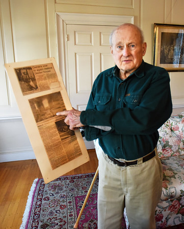 BRYAN EATON/Staff photo. Quill with Daily News clippings of the 1988 fire that damaged the Dexter House, which he had been restoring.
