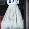 BRYAN EATON/Staff photo. The people at Pure Bliss in Newburyport appear to be Patriot's fan, topping a wedding dress with Rob Gronkowski's jersey number.