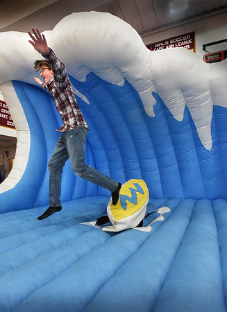 "BRYAN EATON/Staff photo. Newburyport High School partnered with Newburyport Youth Services to create the first-ever ""stress free zone"" in the school's gymnasium during midterm exams with students unwinding with an obstacle course, inflated jousting and here, mechanical surfing."