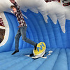 """BRYAN EATON/Staff photo. Newburyport High School partnered with Newburyport Youth Services to create the first-ever """"stress free zone"""" in the school's gymnasium during midterm exams with students unwinding with an obstacle course, inflated jousting and here, mechanical surfing."""