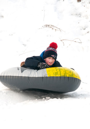 JIM VAIKNORAS/Staff photo Cole Howard , 9,, sleds on the Bartlet Mall in Newburyport Saturday.