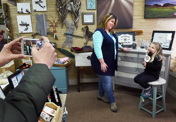 BRYAN EATON/Staff photo. Hannah Toomey, 4, daughter of Crave owner Sean Toomey, interviews Coleen Magowan, owner of 18 Friend Street, as Cassandra Gove takes video, left.