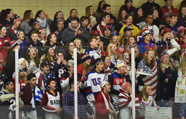 "Newburyport High School fans cheer on their hockey team as they hosted Triton on Wednesday night with the theme ""Team USA"" changing themes at different sporting events. Newburyport was leading 2-0 after the first period. --BRYAN EATON/Staff photo."