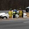 BRYAN EATON/Staff photo. Newburyport firefighters and state police respond to a car in the median on Interstate 95, just south of Route 113 in Newburyport late Tuesday morning. Many spinouts and cars off the road, including a tractor trailer, occured during the icy weather.
