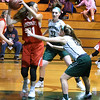BRYAN EATON/Staff photo. Elise Linehan and Jess Galvin put the pressure on Amesbury's Allison Napoli.