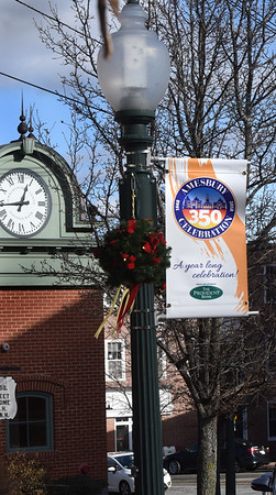 BRYAN EATON/Staff photo. Banners commemoration Amesbury's 350th anniversary have been installed in many spots in the downtown.