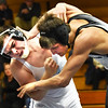 BRYAN EATON/Staff photo. Triton's Brandon Eppa, left, took this match with Marblehead-Swampscott's Stephen Ratner in the 160 class.