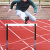 BRYAN EATON/Staff photo. Jack Clohisy goes over some hurdles.