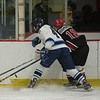 JIM VAIKNORAS/Staff photo Triton's Josh D'Arcy fights for the puck with Amesbury's Patrick Birmingham at the Graf Rink Wednesday night.