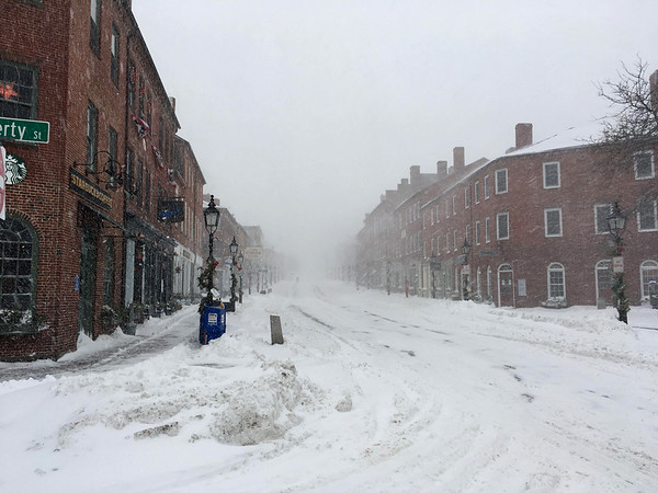 RICHARD K. LODGE/Staff photo. State Street in Newburyport, looking up from Liberty Street, was a ghost town early Thursday afternoon as heavy snow continued to blow through the region.
