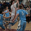 JIM VAIKNORAS/Staff photo Newburyport's Harry Bovee glides to the basket against Triton at Newburyport Friday night.