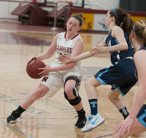 JIM VAIKNORAS/Staff photo Newburyport's Anna Hickman guards the ball against Triton at Newburyport Friday night.