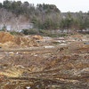 BRYAN EATON/Staff photo. Clear-cutting and grading of the site of condominiums at Bailey's Pond, seen in back, is underway in Amesbury. View is from Route 150 where Alan's Truck Stop used to be.