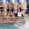 BRYAN EATON/Staff photo. Triton swimmers cheer on their teammates.