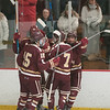 JIM VAIKNORAS/Staff photo Newburyport players celebrate their first goal against Triton at the Graf Rink in Newburyport Saturday