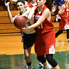BRYAN EATON/Staff photo. Pentucket's Casey Hunt pushes the ball from Amesbury's Allison Napoli.