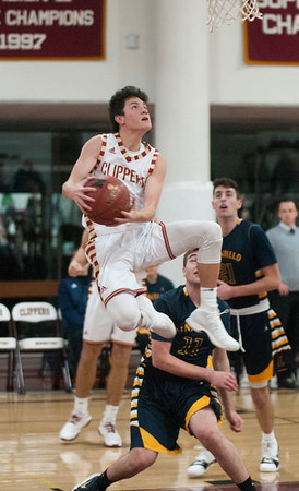 JIM VAIKNORAS/Staff photo Newburyport's Ryan Archie scores on a reverse lay-up against Lynnfield at Newburyport  Friday night.