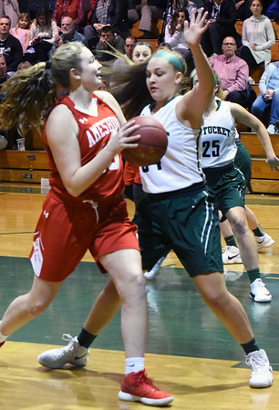 BRYAN EATON/Staff photo. Pentucket's MacKenzie Currie puts the defense on Mary Bullis.
