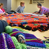 BRYAN EATON/Staff photo. Ladies work at the Amesbury Senior Center on Blankets for Kids which are made for various recipients, including families that may be in need. They meet every Tuesday and monetary donations or those of materials are always welcome.