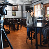 "BRYAN EATON/Staff photo. ""Small Business Revolution-Main Street"" photographer Scott Thompson films host Amanda Brinkman, right, interviewing Crave Restaurant owner Sean Toomey on Thursday afternoon. Amesbury is one of the 10 finalist towns and cities to be chosen winner of the next installment of the show."
