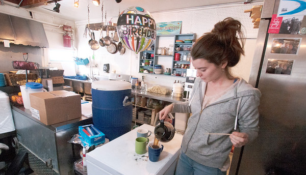 JIM VAIKNORAS/Staff photo Waitress Erica Reusse of Mad Martha's on Plum Island pours coffee Friday morning. The local eatery was opened after being closed for a few days after a pipe burst due to the cold weather.