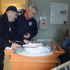 JIM VAIKNORAS/Staff photo  Newburyport Fire fighter Bob Morse and Fire Chief Christopher LeClaire visit  Jayden Matombo in his room at the Anna Jaques. Morse along with 3 of his co-workers delivered him in front of Station #2 Thursday.