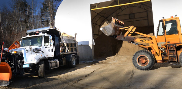 BRYAN EATON/Staff photo. Chuck St. Cyr of the Salisbury DPW loads a sand and salt mix into the town's newest truck to be ready for today's storm.