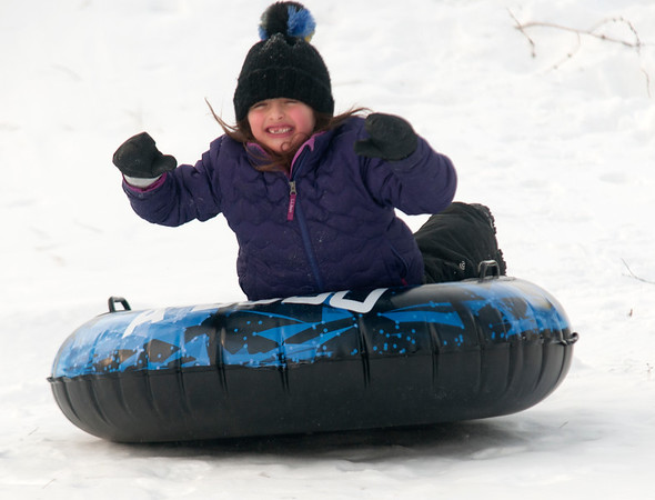 JIM VAIKNORAS/Staff photo Ruby Wallace, 6, of Newburyport goes airborne while sledding on the Bartlet Mall in Newburyport Saturday.