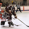 CARL RUSSO/staff photo. NEWBURYPORT NEWS: Newburyport's assistant captain,vOwen Bradbury controls the puck against Amesbury's Cameron Chambers. Newburyport high and Amesbury high/ Whittier Tech. in hockey action Monday night. 1/22/2018