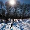 JIM VAIKNORAS/Staff photo A sledder makes his way back up the hill under a bright sun at Marches Hill in Newburyport Sunday afternoon.