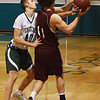 BRYAN EATON/Staff photo. Pentucket's Sam Stys puts the pressure on Rockport's Benjamin Bradley.