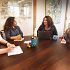 BRYAN EATON/Staff photo. Koya Leadership Partners founder and CEO Katie Bouton, second from right, meets with several staff members. From left, Gillian Stewart, research associate; Melissa Madzel, principal executive search; Bouton and Turner Delano, consultant.