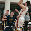 JIM VAIKNORAS/Staff photo Newburyport's Harry Bovee shoots over Lynnfield's Daniel Jameson at Newburyport Friday night.