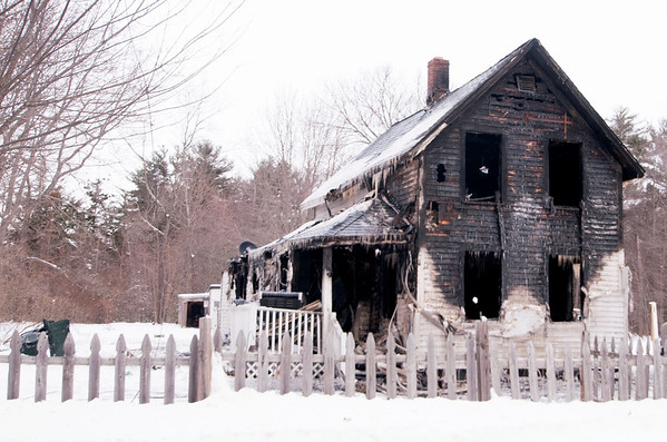 JIM VAIKNORAS/Staff photo Scene of a devastating fire at 35 farm Lane in Seabrook Early Saturday morning.