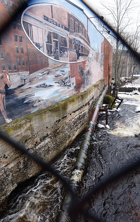 BRYAN EATON/Staff photo. The steam pipe that runs along the Powow River in downtown Amesbury may be coming down.