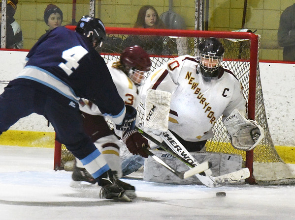 BRYAN EATON/Staff photo. Newburyport goalie Kenneth Hodge makes the save on a shot by Joshua D'Arcy.