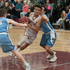 JIM VAIKNORAS/Staff photo Newburyport's Beorge Coryell  drives to the basket against Triton at Newburyport Friday night.