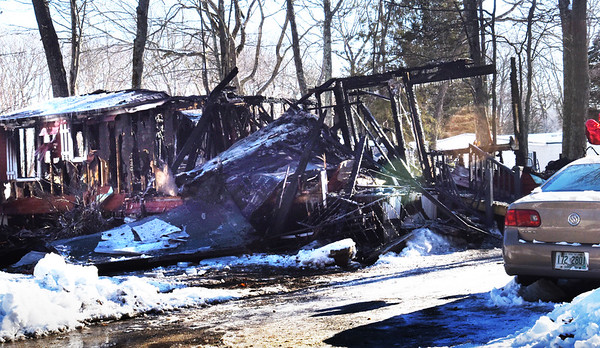 BRYAN EATON/Staff photo. A mobile home on Norman Road in Seabrook is just a shell as fire destroyed the building on New Year's Day claiming the life of a female occupant.