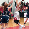 JIM VAIKNORAS/Staff photo Amesbury's Allison Napoli shoots against Hamilton-Wenham at Amesbury Friday night.