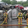 Merrimac: A fire engulfed this truck cab along with two of the cars it was carrying in the rest area in Merrimac on Insterstate 495 south. The driver was able to escape unharmed. Bryan Eaton/Staff Photo