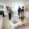 BRYAN EATON/Staff photo. Museum of Old Newbury volunteer Wanda Blanchard shows the completed living room to Jeffrey and Barbara Goldberg of Burlington.
