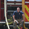 JIM VAIKNORAS/Staff photo A firefighter tries to cool off while battling a fire on CCC road in Salisbury.