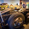 BRYAN EATON/Staff photo. Andrew Amigo, CEO of Blackburn Energy shows the battery compartment of a tractor-trailer unit at the Chestnut Innovation Center in Amesbury. His company is working to harness extra energy wasted during the operation of the units and convert it into electricity to be stored in the battery which can be used, among other things, to air condition the unit when the engine is off.