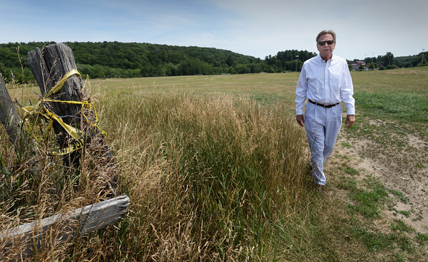 BRYAN EATON/Staff photo. Richard Ross, shown at Woodsom Farm where new soccer fields are proposed, is hoping for Amesbury to pass the Community Preservation Act.